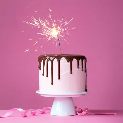 birthday sign ups ; family-birthday-cake-sparkler-pink-ribbons