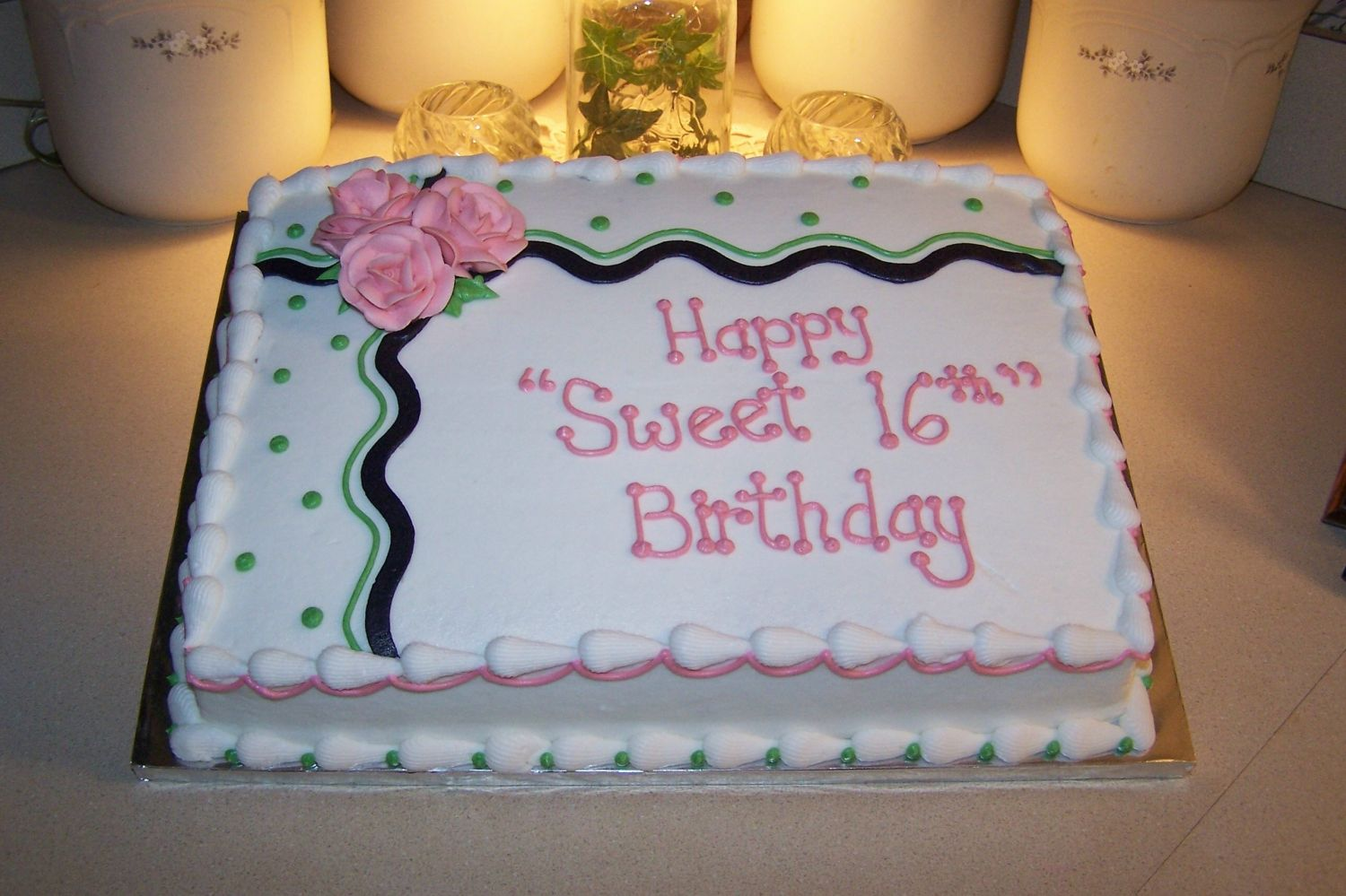 decorating a sheet cake for birthday ; 3063870cae78906a81836140287573a4