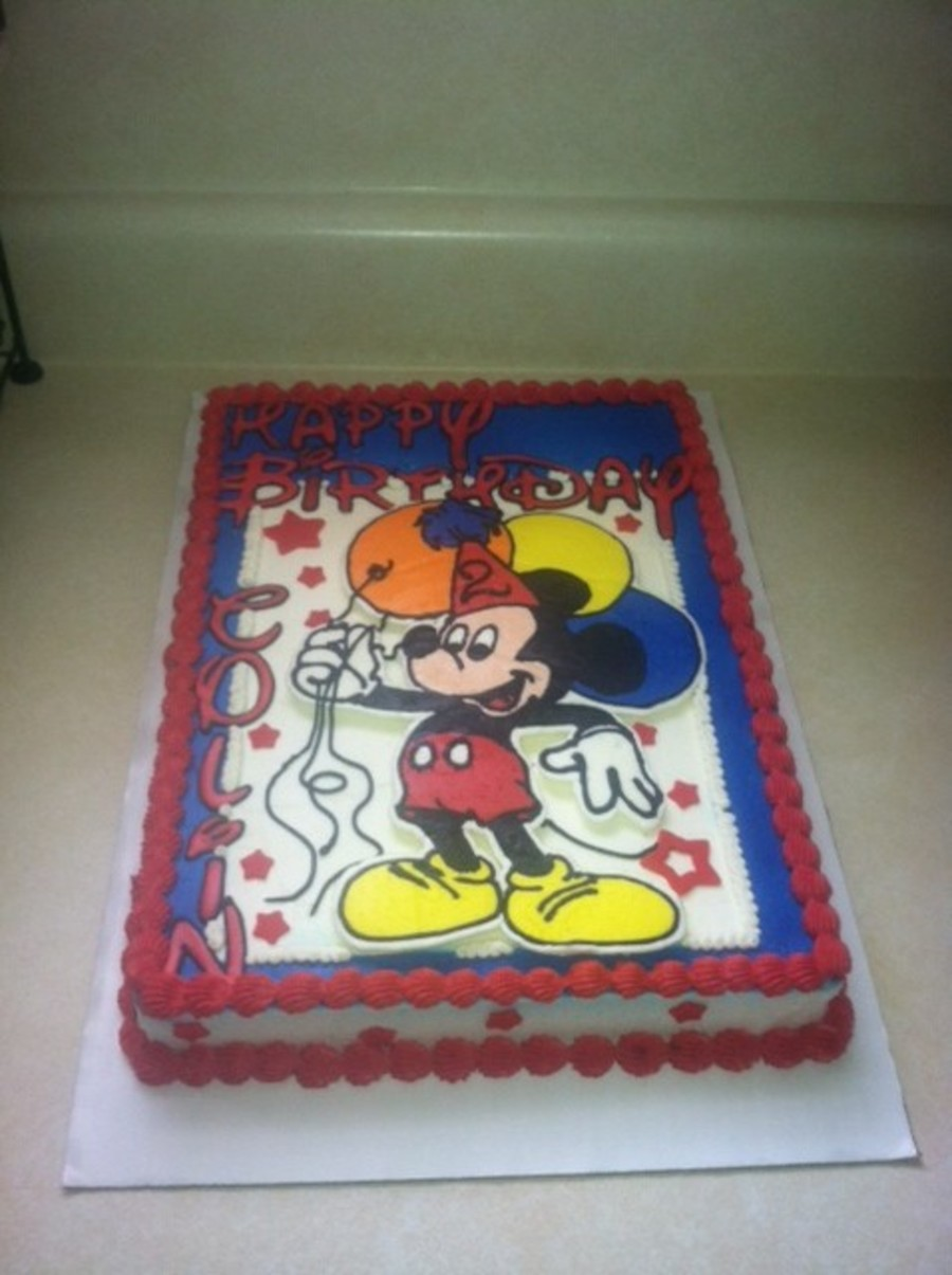 decorating a sheet cake for birthday ; 900_878137FIt8_mickey-mouse-birthday-sheet-cake