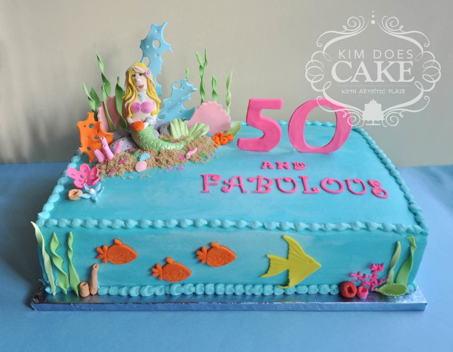 decorating a sheet cake for birthday ; 900_asbc4qV0So-mermaid-birthday-cake