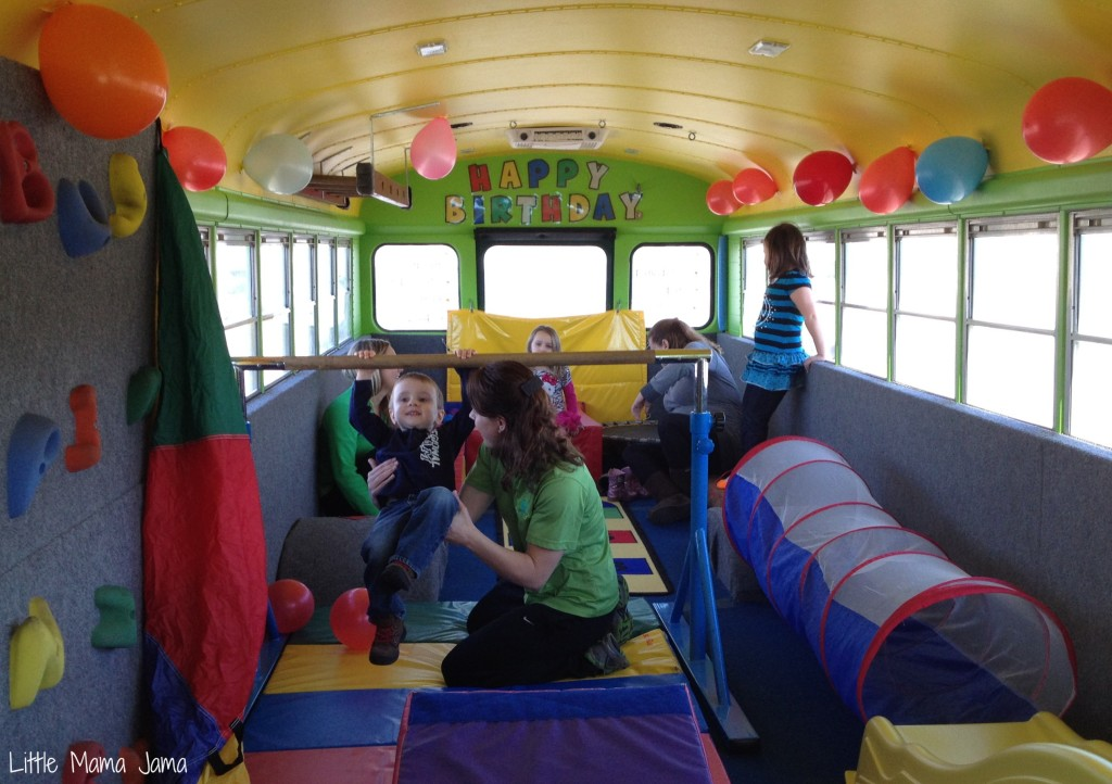fun activities at birthday parties ; Toddler-swinging-from-the-bar-on-the-Bouncin-Bus-1024x722