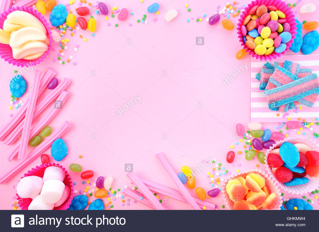 colorful birthday borders ; background-with-decorated-borders-of-bright-colorful-candy-on-pink-GHKMW4
