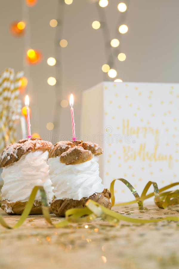 make a birthday wish picture ; make-birthday-wish-cream-puffs-candles-card-lying-table-65987382