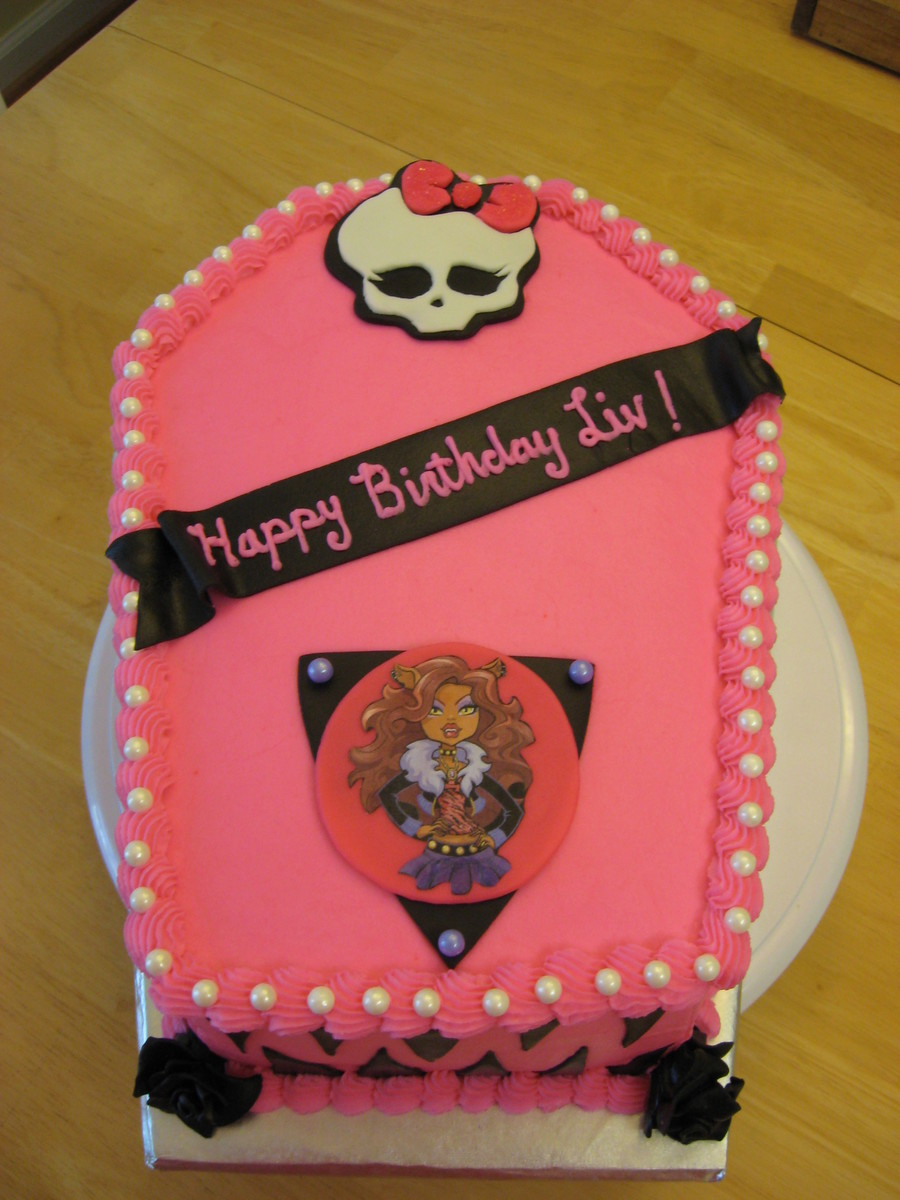 monster high birthday sheet cake ; 900_706641VA6F_monster-high-birthday-cake-i-took-a-12-sheet-cake-cut-in-half-and-stacked-it-then-carved-into-coffin-shape-skull-if-fondant-and-printe