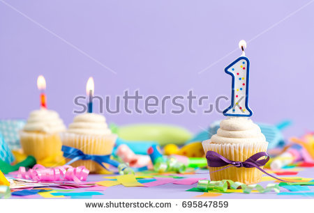 birthday celebration theme ; stock-photo-first-birthday-celebration-theme-with-cupcake-candle-and-party-accessories-695847859