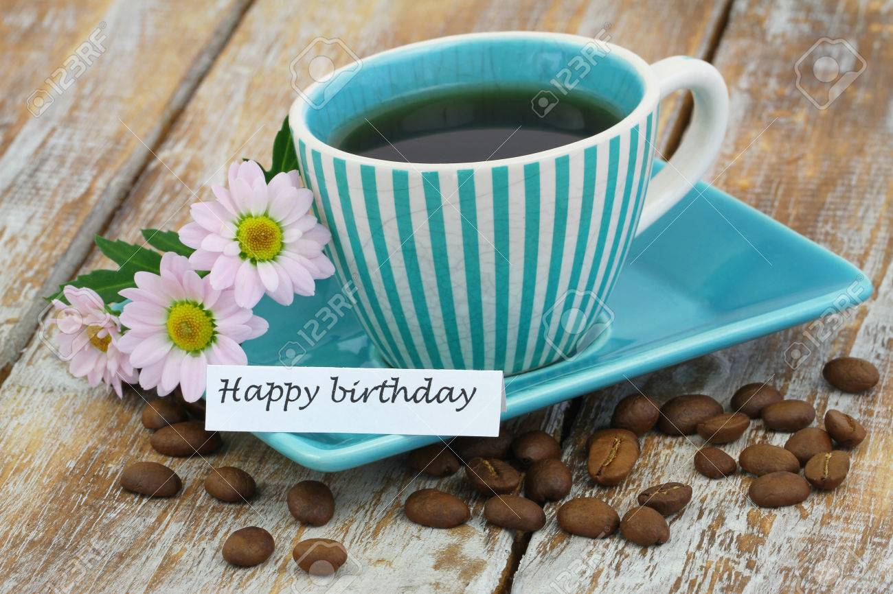 happy birthday coffee images ; 45884657-happy-birthday-card-with-cup-of-coffee-and-pink-daisies-on-rustic-wooden-surface