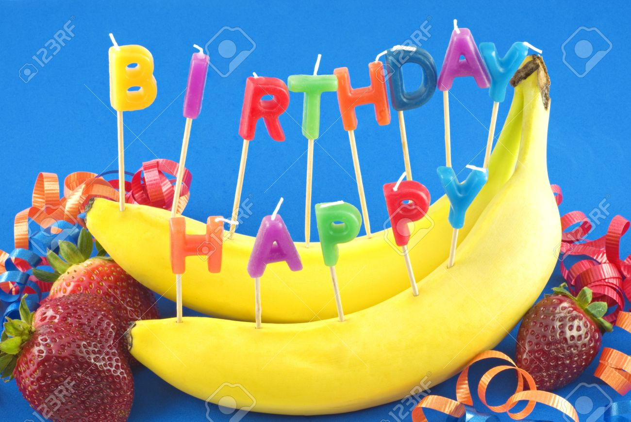 happy birthday healthy ; 10044107-candles-spelling-happy-birthday-stuck-in-bananas-instead-of-cake-for-healthy-lifestyle-birthday-blue