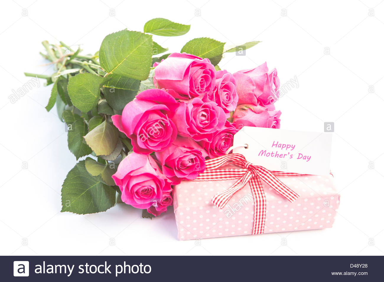 happy birthday pink roses ; bouquet-of-pink-roses-next-to-a-gift-with-a-happy-birthday-card-D48Y28