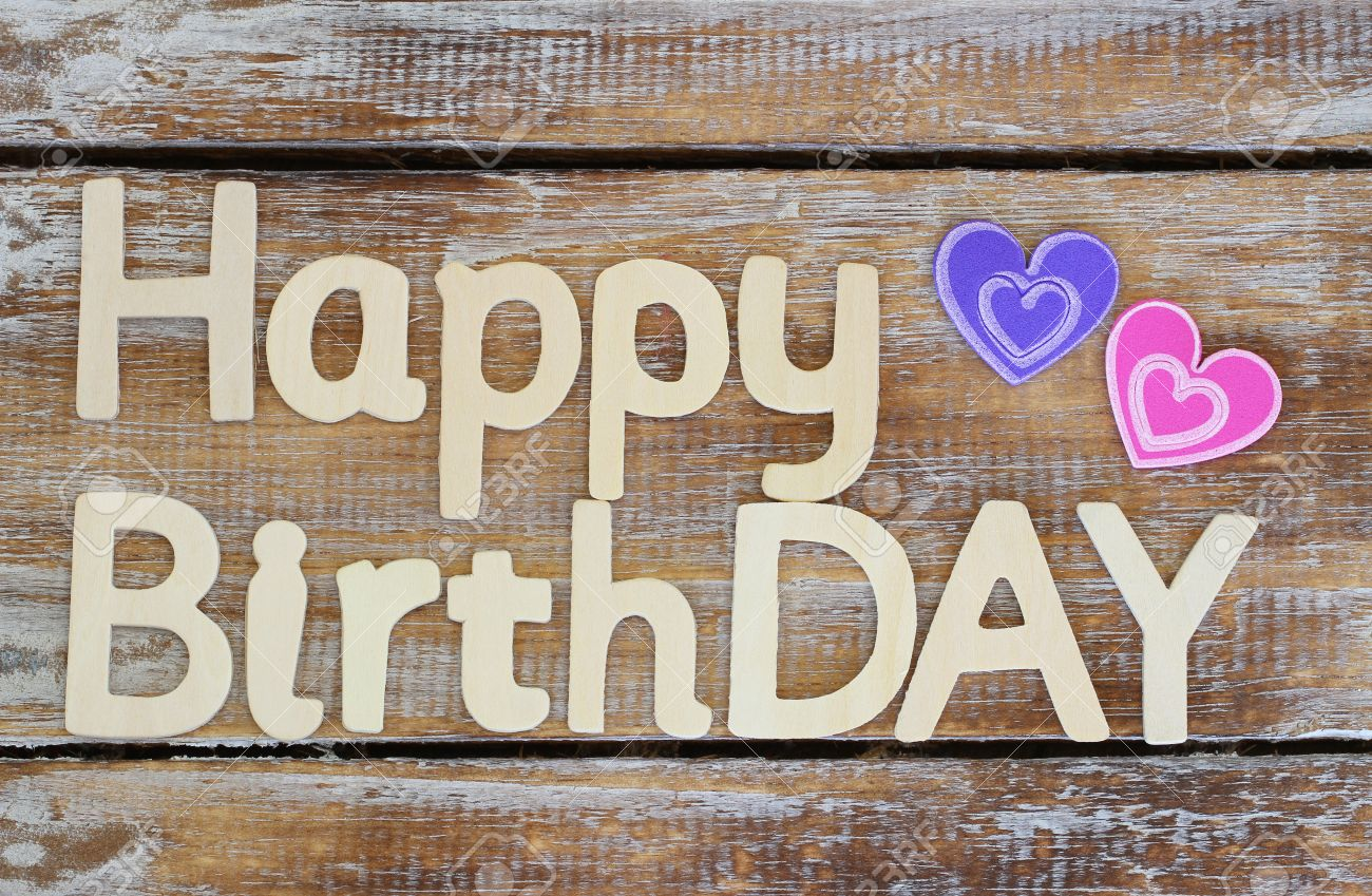 happy birthday wood ; 42150982-happy-birthday-written-with-wooden-letters-on-rustic-wood