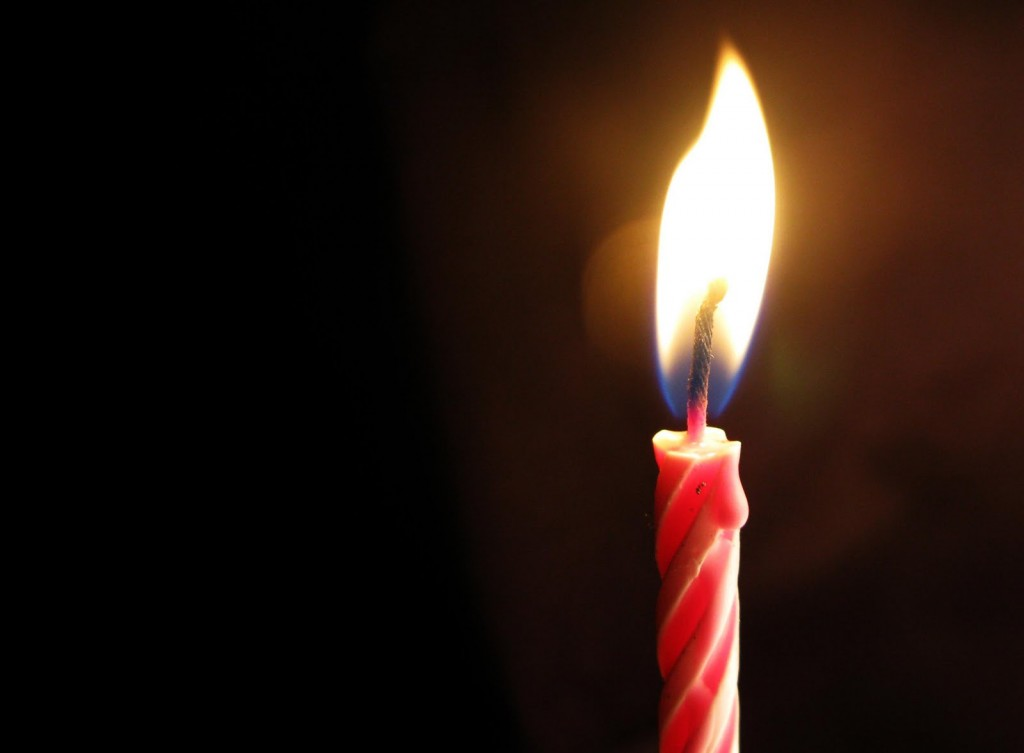 image of a birthday candle ; birthday-candle-1024x753