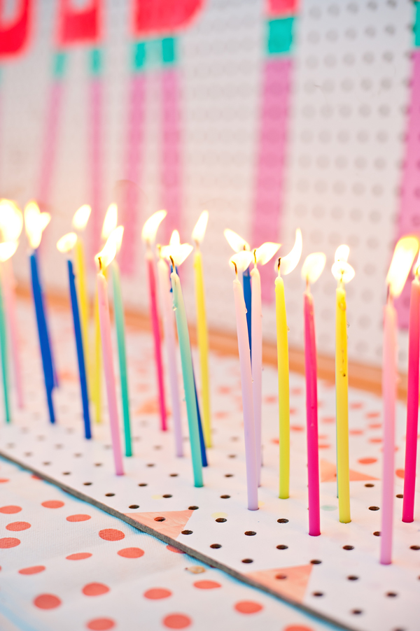 image of a birthday candle ; peg-board