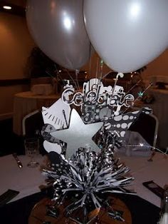 picture centerpieces for birthday party ; c43d9f7c873767559c441e5c027dd594--th-birthday-centerpieces-black-centerpieces