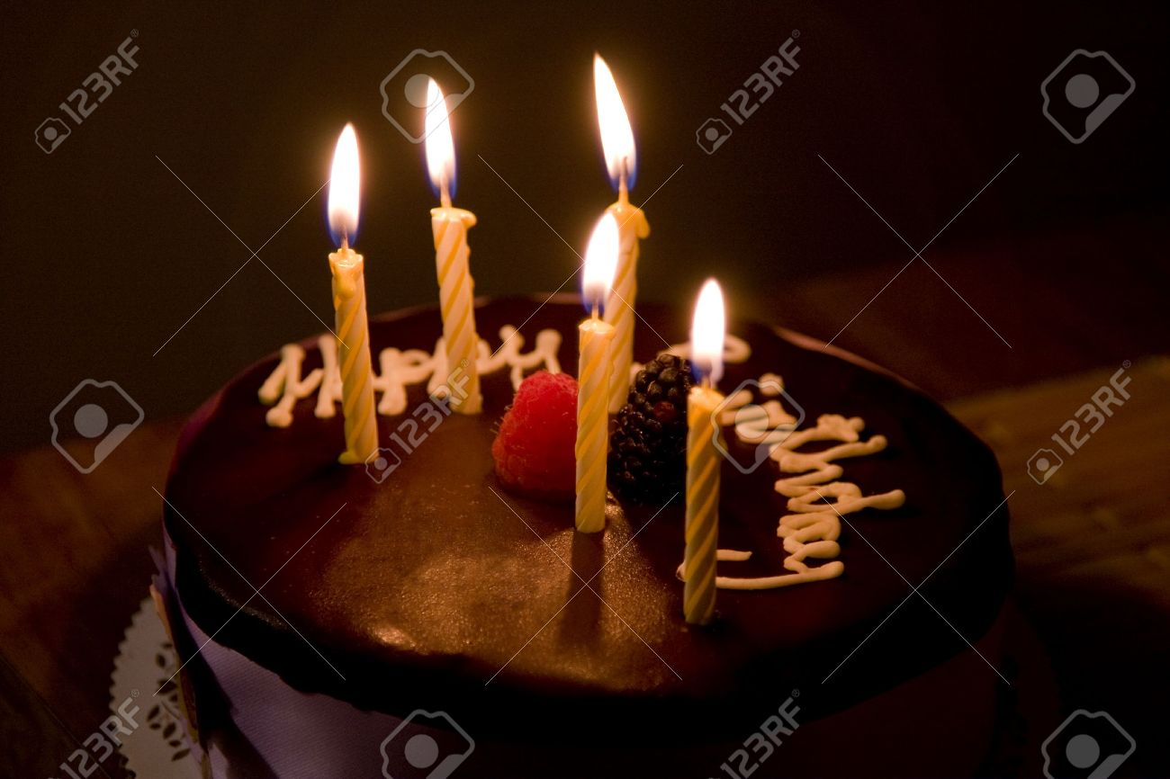 picture of birthday cake with burning candles ; 4968511-happy-birthday-cake-with-burning-candles