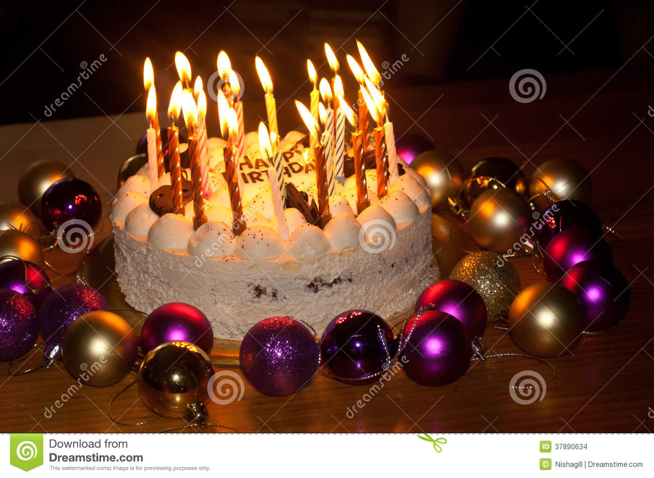 picture of birthday cake with burning candles ; birthday-cake-burning-candles-37890634