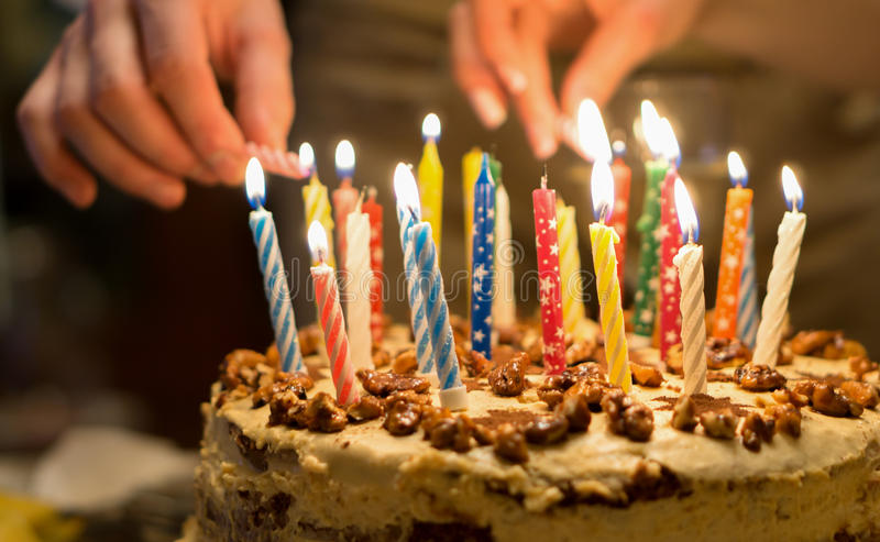 picture of birthday cake with burning candles ; birthday-cake-burning-candles-dark-background-69945047