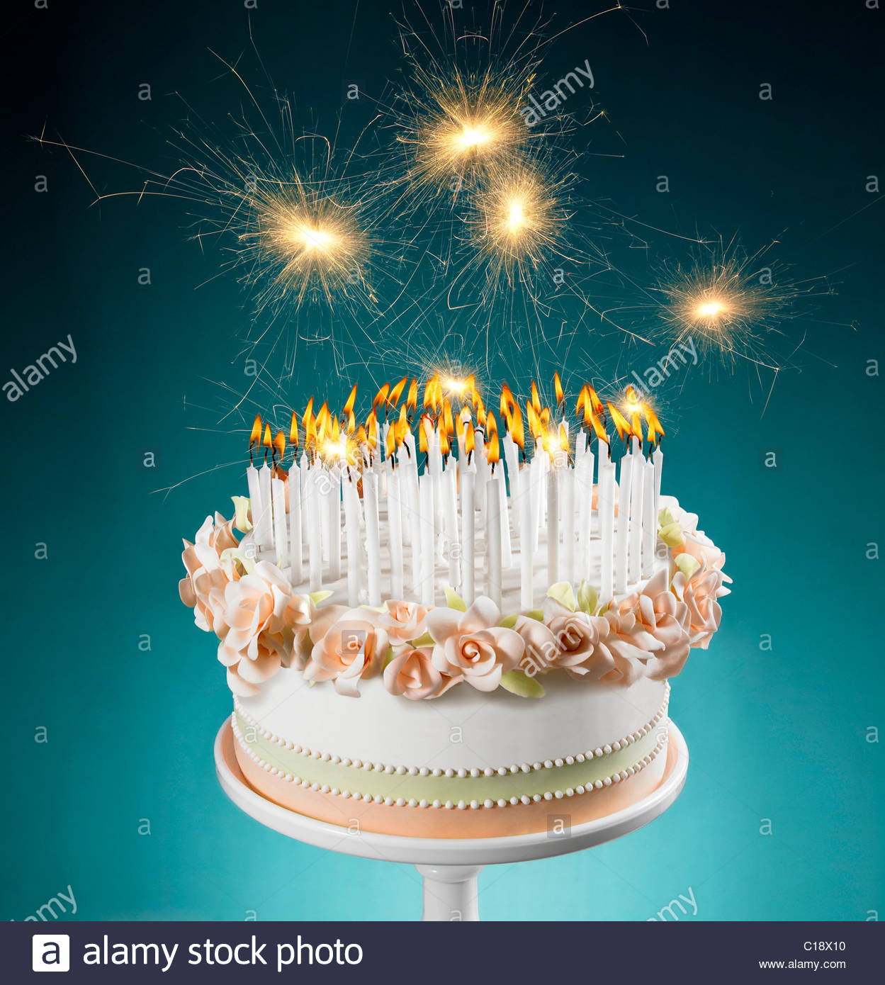 picture of birthday cake with burning candles ; birthday-cake-with-lots-of-burning-candles-C18X10