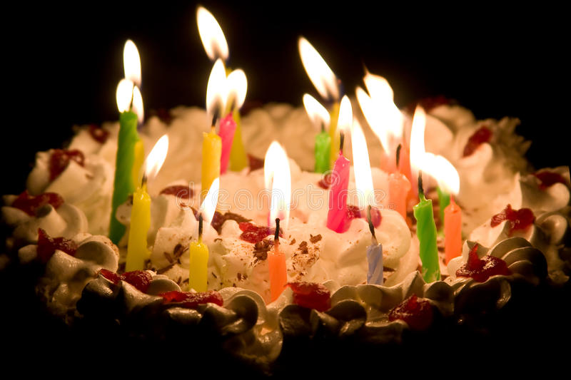 picture of birthday cake with burning candles ; happy-birthday-cake-burning-candles-12160273
