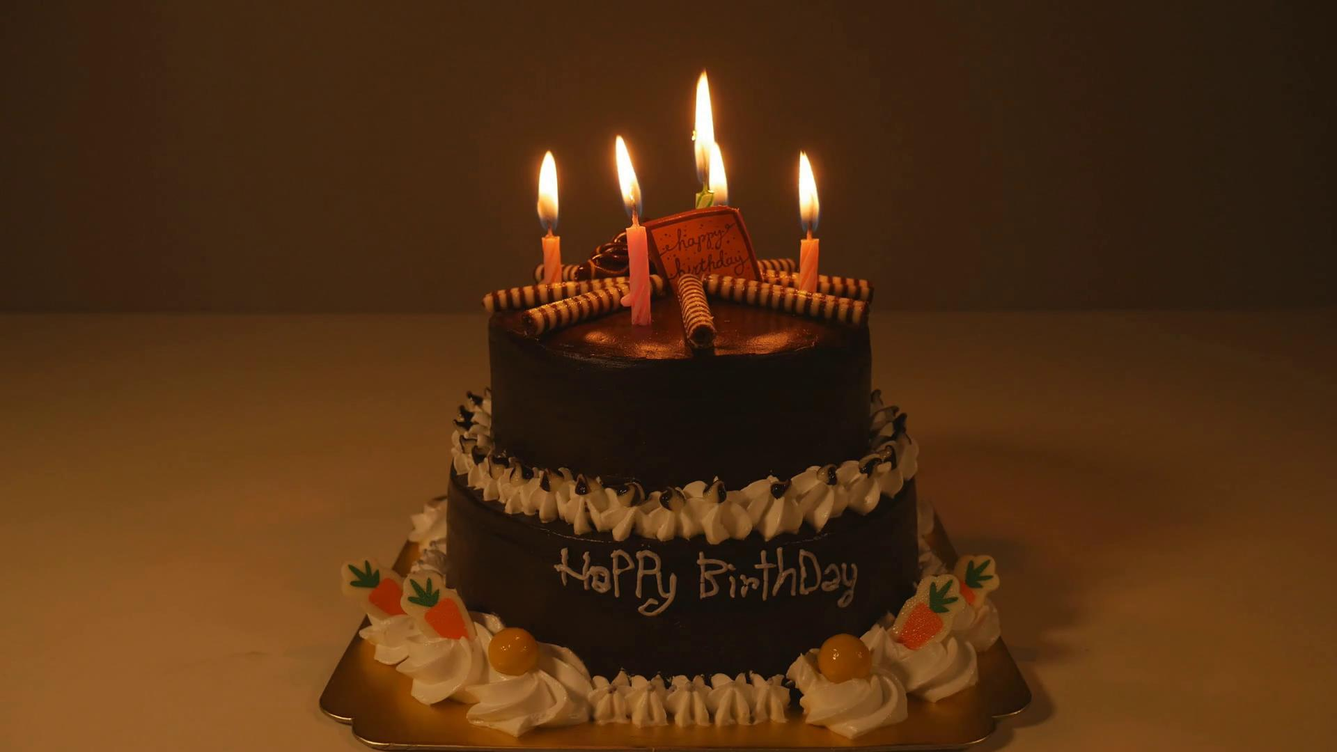 picture of birthday cake with burning candles ; videoblocks-4k-of-happy-birthday-cake-with-burning-spiral-candles_rnua3u2bz_thumbnail-full01