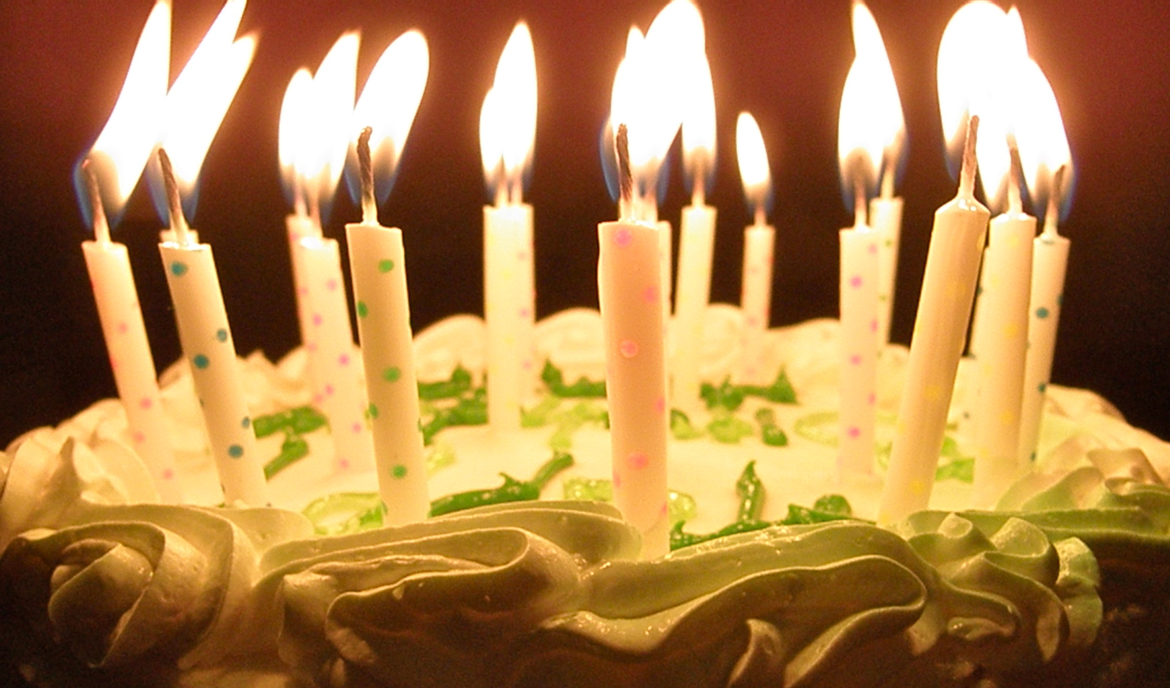 picture of birthday candles burning ; Holidays___Birthday_Burning_candles_in_a_cake_for_birthday_051795_