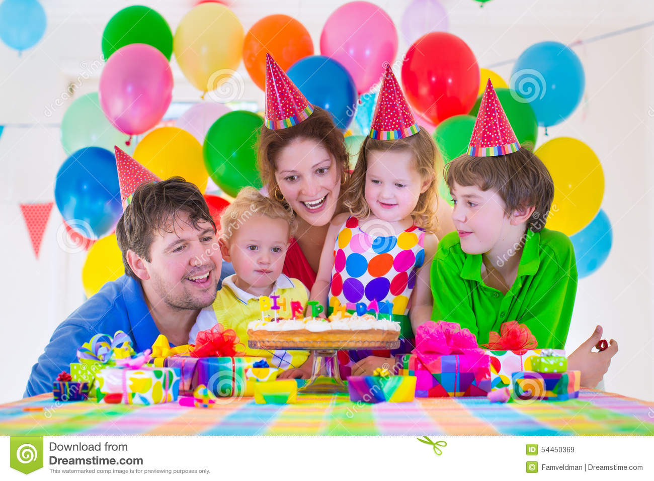picture of birthday party celebration ; family-celebrating-birthday-party-happy-kids-parents-three-children-celebrate-together-child-baloon-decoration-cake-54450369
