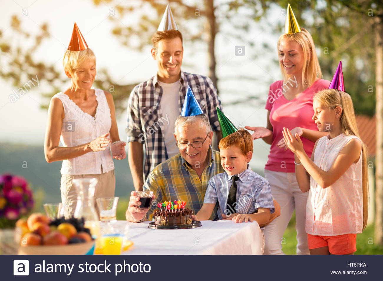 picture of birthday party celebration ; grandfather-and-grandson-on-birthday-party-celebration-with-family-HT6PKA