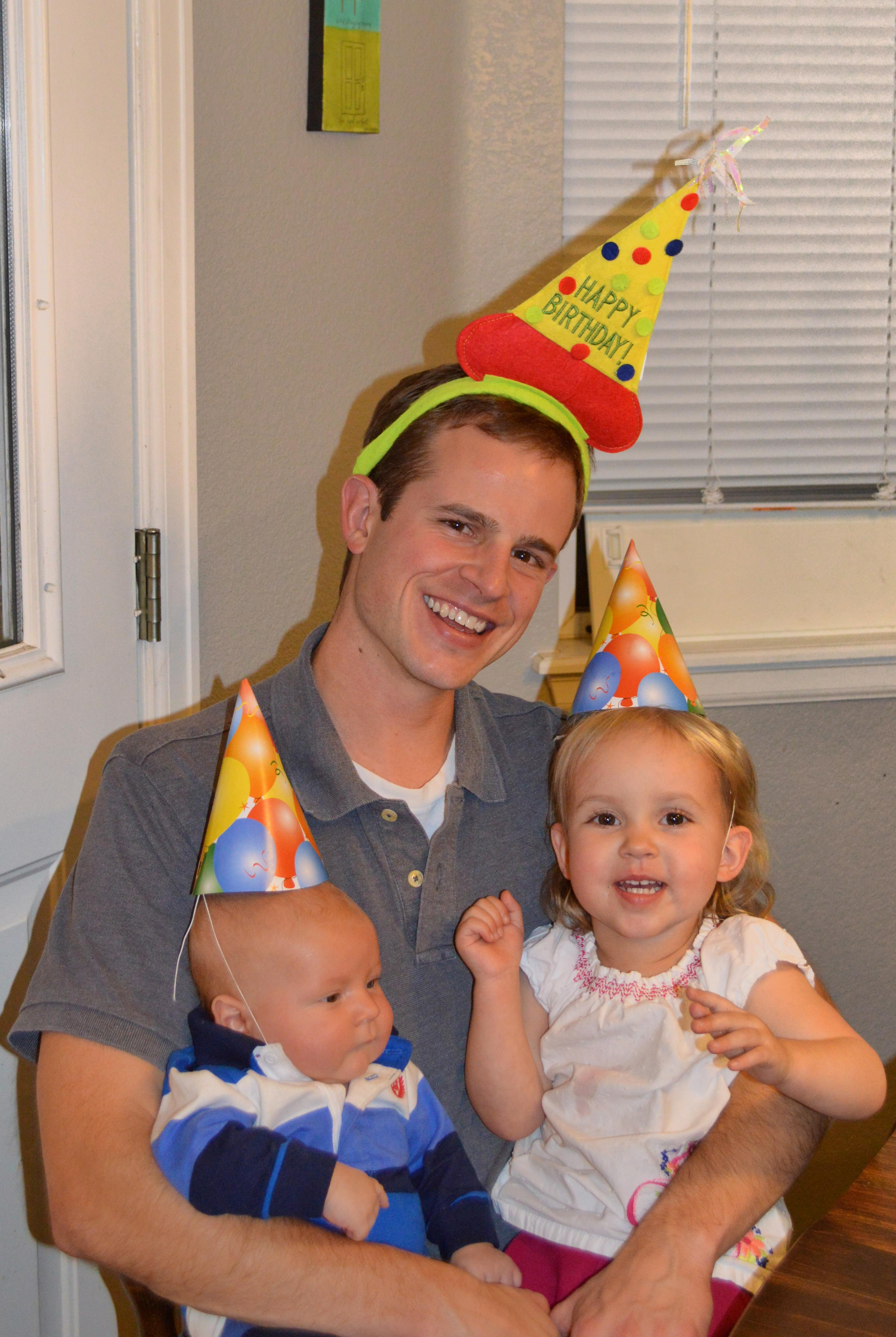 put a birthday hat on a picture ; daddy-and-kids