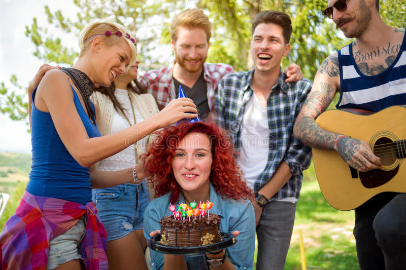put a birthday hat on a picture ; friend-put-to-birthday-hat-head-reveler-female-sweet-70131844