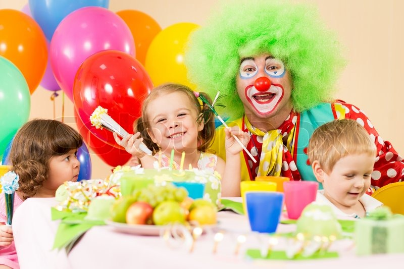 stock image birthday ; 4861541-kids-celebrating-birthday-party-with-clown
