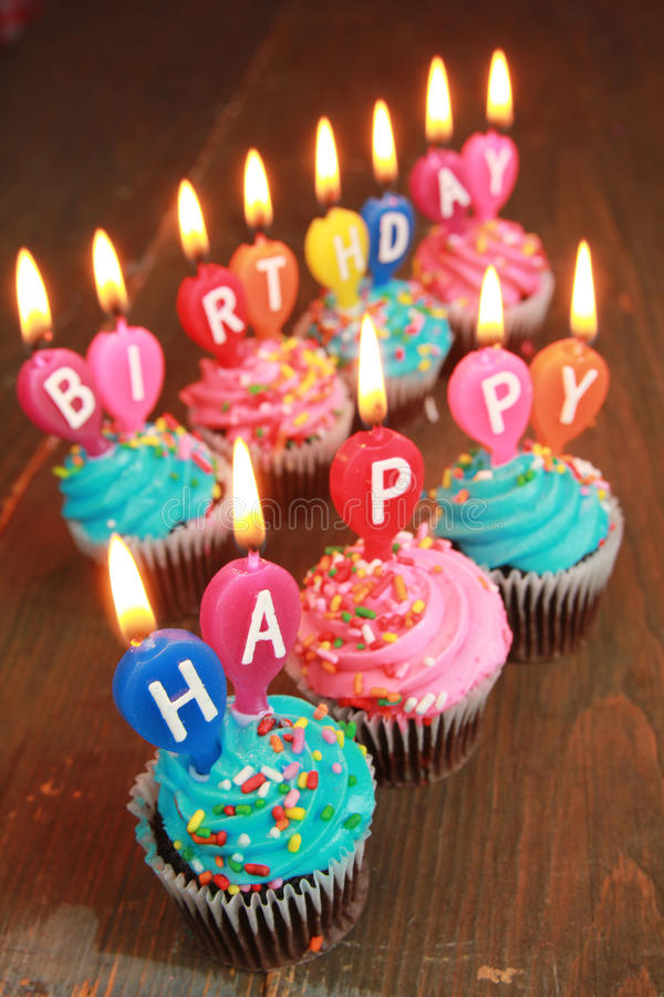 a picture saying happy birthday ; happy-birthday-pink-blue-icing-cupcakes-candles-saying-32819865