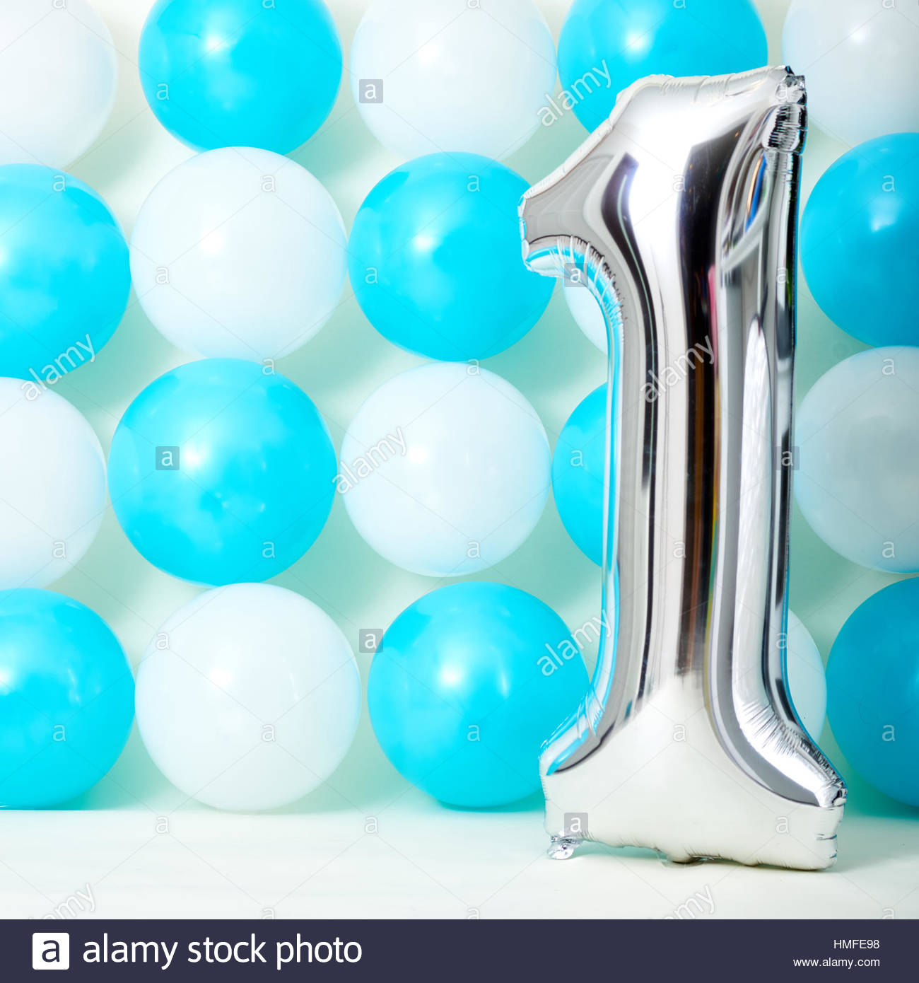 first birthday background images ; shiny-first-birthday-balloon-with-blue-and-white-balloons-background-HMFE98