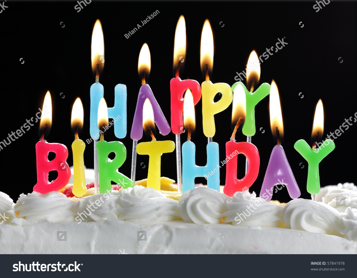happy birthday cake with candles ; stock-photo-colorful-happy-birthday-candles-burning-on-a-cake-57841978