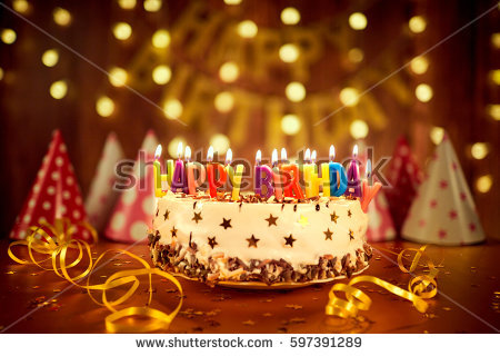 happy birthday cake with candles ; stock-photo-happy-birthday-cake-with-candles-on-the-background-of-garlands-a-597391289