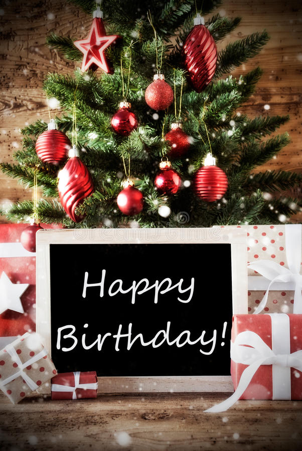happy birthday christmas ; christmas-tree-happy-birthday-card-seasons-greetings-balls-gifts-presents-front-wooden-background-chalkboard-78636320