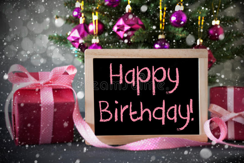 happy birthday christmas ; tree-gifts-snowflakes-bokeh-text-happy-birthday-christmas-rose-quartz-balls-effect-presents-front-cement-81070202