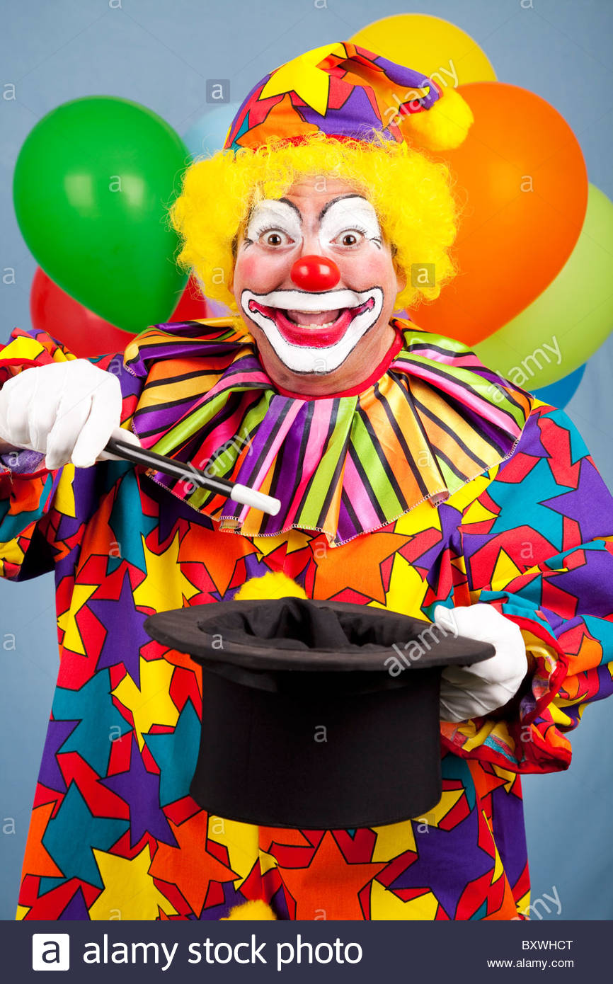 happy birthday magic image ; happy-birthday-clown-does-a-magic-trick-with-a-top-hat-and-wand-BXWHCT