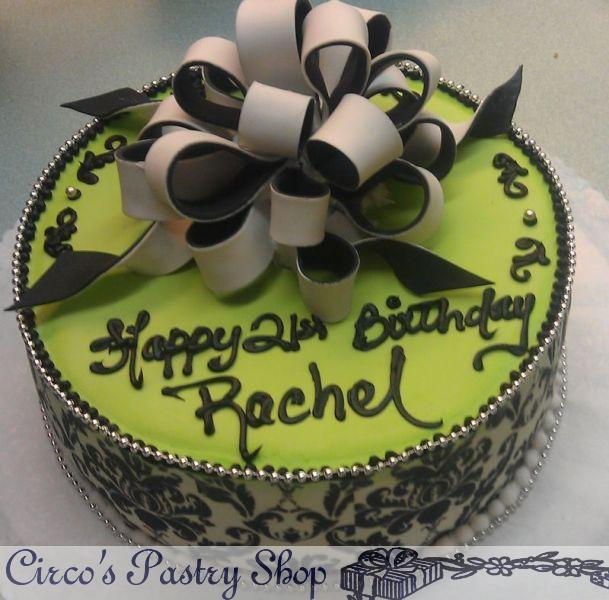 specialty birthday cakes photo gallery ; custom-birthday-cakes-nyc-round-green-cream-floral-pattern-vintage-cake-with-custom-name-2-tone-black-and-white-loop-bow-with-the-damask-print