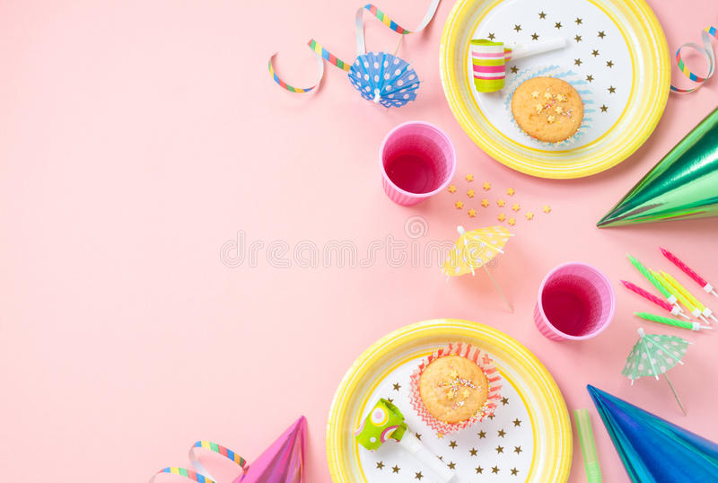 birthday background layout ; girl-birthday-decorations-pink-table-setting-above-muffins-drinks-party-gadgets-background-layout-free-text-39356262