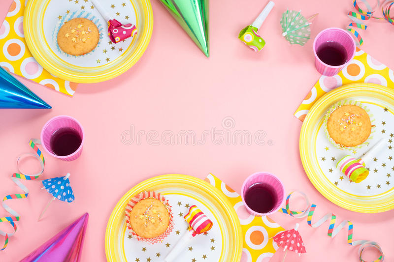 birthday background layout ; girl-birthday-party-pink-table-setting-above-muffins-drinks-gadgets-background-layout-free-text-space-39140727