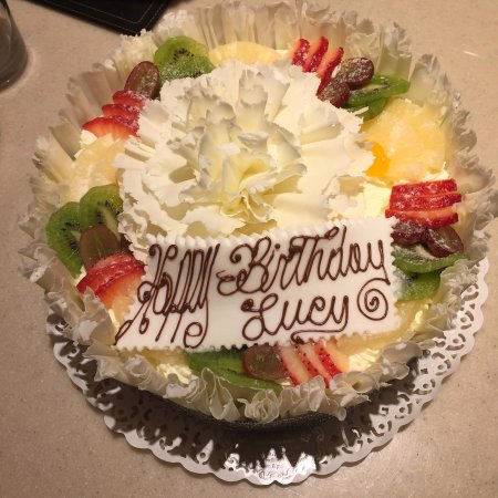 birthday cake with photo on top ; top-view-of-fresh-fruit