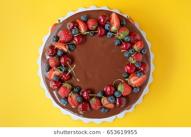 birthday cake with picture on top ; birthday-cake-chocolate-strawberries-blueberries-260nw-653619955