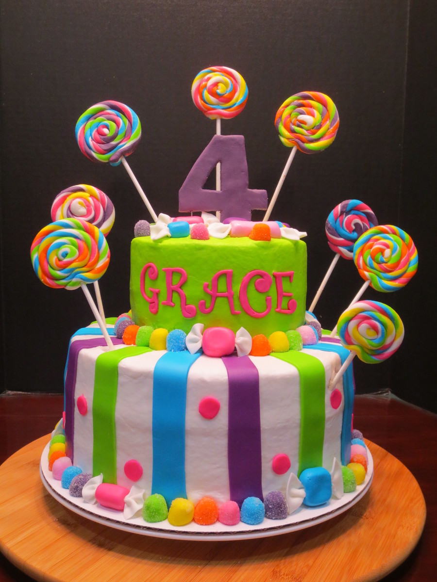 bright colored birthday cakes ; 900_37891gTjq_i-had-so-much-fun-doing-this-bright-and-colorful-birthday-cake-all-the-accents-are-made-from-mmf-i-love-the-lollipops-and-wrapped-candy