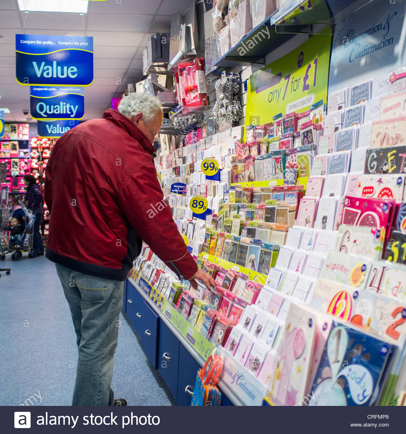 card factory birthday cards ; a-man-browsing-through-birthday-cards-in-a-branch-of-the-card-factory-CRFMP9