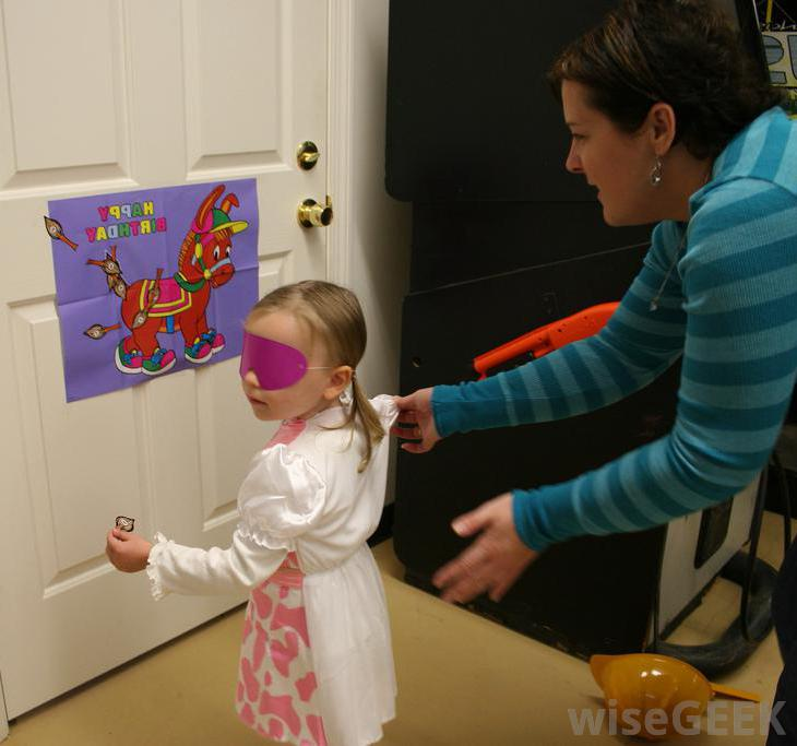 children's games birthday party ideas ; child-blindfolded-near-donkey-tail-game