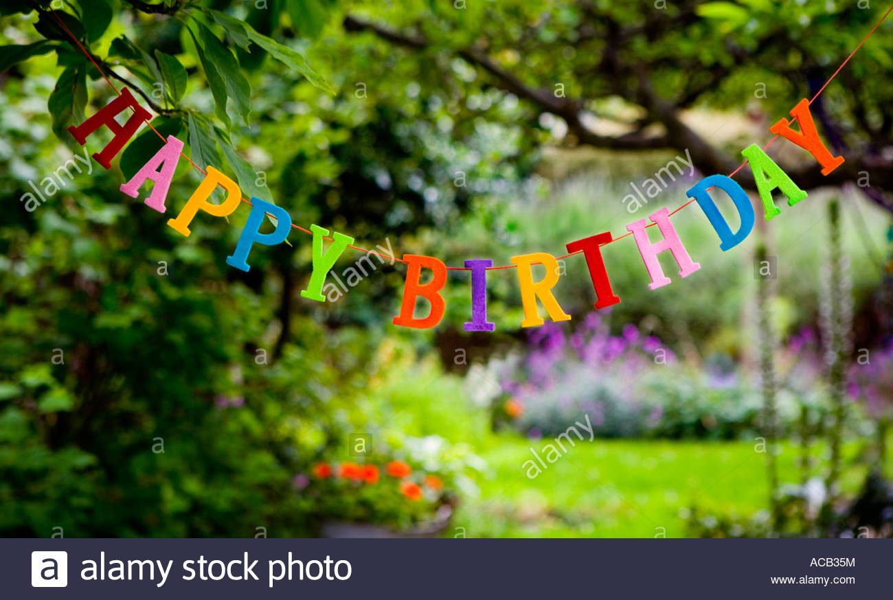 happy birthday garden images ; happy-birthday-sign-hanging-in-a-garden-ACB35M