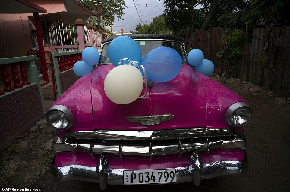 happy birthday in cuban ; 3De7jyJOTf836d8c0e215066b61e-3377057-In_this_Dec_20_2015_photo_a_classic_American_car_sits_decorated_-a-55_1451467475216