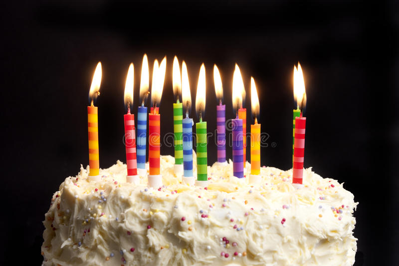 picture of birthday cake and candles ; birthday-cake-candles-black-background-18531990