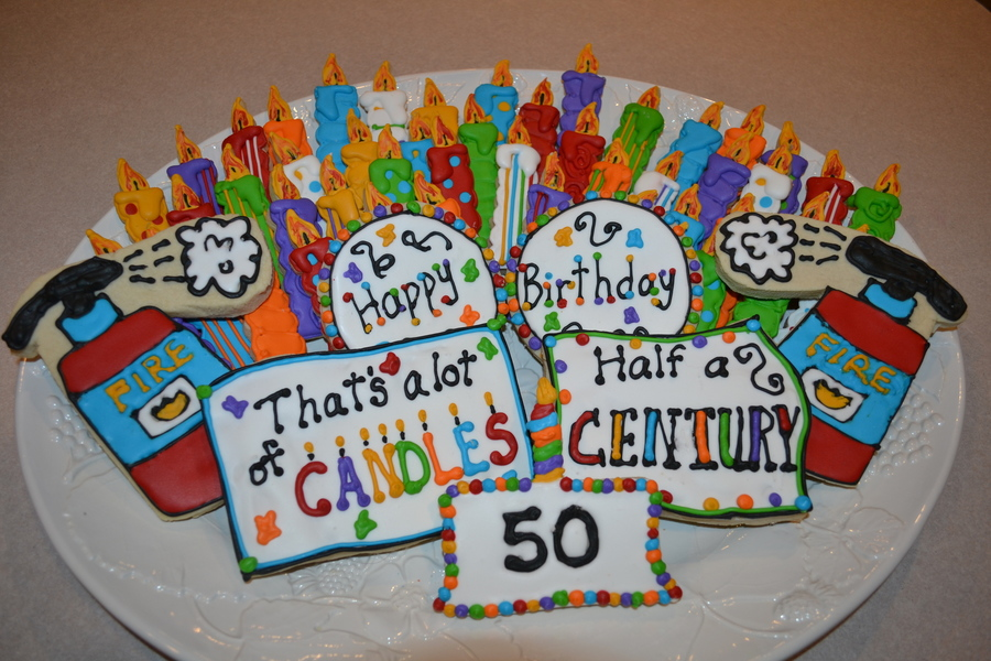 picture of birthday cake with 50 candles ; 900_802744n2Wi_50th-birthday-cookie-display-with-50-candle-cookies-and-fire-extinguishers